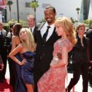 Isaiah Mustafa and Kathy Griffin - 454 x 681