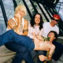 Flea with Anthony Kiedis, John Frusciante and Chad Smith
