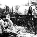 Micky Dolenz holding his daughter Ami, Samantha Dolenz, Linda Haines, and Davy with daughter Talia