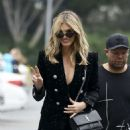 Delta Goodrem – Arriving on Extra! in Los Angeles - 454 x 591