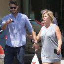 Jennie Garth and husband Dave Abrams g out shopping at Macy's in Los Angeles, California on August 26, 2016 - 454 x 545