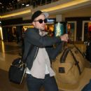 Robert Pattinson departs from LAX and arrives in Berlin February 15, 2012