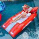 Miley Cyrus in Red Bikini in the pool – Instagram