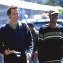 Norm MacDonald as Willard Fillmore and Dave Chappelle as Rusty P. Hayes in Universal's comedy Screwed - 2000 - 400 x 273