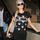 Paris Hilton - Arriving At LAX From Egypt - June 4, 2010
