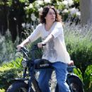 Lena Headey – Seen on a electric motorbike in Los Angeles