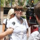 Janine Lindemulder speaks with reporters outsidet the Lamoreaux Justice Center to hear an expected ruling on visitation rights in her child-custody battle with ex-Jesse James. Lindemulder is fighting for visitation rights with their 6-year-old daughter - 454 x 303