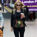 Kate Moss – Arriving at London Heathrow Airport - 454 x 715