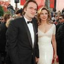 Quentin Tarantino and Mira Sorvino attendsThe 69th Annual Academy Awards (1997) - 335 x 612