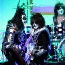 Musicians Gene Simmons, Tommy Thayer and Eric Singer of KISS perform onstage during the 23rd Annual Race To Erase MS Gala at The Beverly Hilton Hotel on April 15, 2016 in Beverly Hills, California - 454 x 309