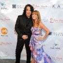 Musician Paul Stanley of KISS and Jane Seymour attend the 5th Annual Open Hearts Foundation Gala on May 9, 2015 in Malibu, California. - 454 x 586
