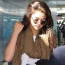 Selena boarding at the Toronto airport in Toronto, Canada Sunday September 7, 2014
