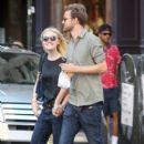 A smitten looking Dakota Fanning and her boyfriend Jamie Strachan go hand in hand for a stroll around New York City - 404 x 594