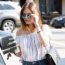 Actress and singer Lucy Hale stops by Starbucks in Los Angeles, California to pick up an iced coffee on August 24, 2016