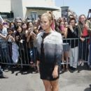 Demi Lovato poses for photos after arriving at ORACLE Arena on June 18, 2012 in Oakland, California
