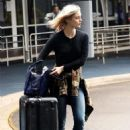 Bella Heathcote in Jeans Arrives at Airport in Sydney March 1, 2017 - 454 x 636