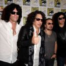 Kiss attends the Scooby-Doo! and Kiss: Rock and Roll Mystery Press Room during Comic-Con International 2015 at the at Hilton Bayfront on July 9, 2015 in San Diego, California. - 454 x 306