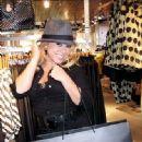 Sabrina Bryan with fedora hat.