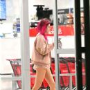 Bella Thorne in pink rabbit slippers and short pink shorts Shopping in LA