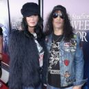 Slash and Meegan Hodges attend Halloween Horror Nights 2018 at Universal Studios Hollywood on September 14, 2018 in Los Angeles, California - 454 x 582