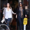 Selena Gomez stops by Starbucks with a friend on November 2, 2014 in Los Angeles, California