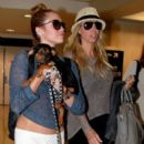 Miley Cyrus at LAX with her mom Tish and sister Brandi after a trip to Miami. May 18, 2012
