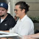 Orlando Bloom is spotted signing autographs at LAX airport in Los Angeles, California on January 26, 2015