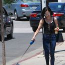 Lucy Hale with her dog Elvis out in Los Angeles