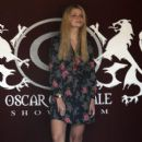 Mischa Barton stops by Oscar Generale's showroom where she tries on a few different items for Oscar