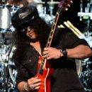 Guitarist Slash performs onstage at the 10th annual MusiCares MAP Fund Benefit Concert at Club Nokia on May 12, 2014 in Los Angeles, California.