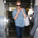 Charlize Theron arriving on a flight at LAX airport in Los Angeles, CA on March 19, 2012