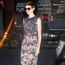 Anne Hathaway leaving the