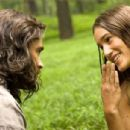 Smith (Colin Farrell) and Pocahontas (Q'orianka Kilcher) explore each other's language.