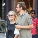 A smitten looking Dakota Fanning and her boyfriend Jamie Strachan go hand in hand for a stroll around New York City - 439 x 594
