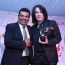 Musician Paul Stanley of KISS and comedian George Lopez attend the 5th Annual Open Hearts Foundation Gala on May 9, 2015 in Malibu, California. - 454 x 336