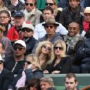 Leonardo DiCaprio and his friend Lukas Haas attend the French tennis Open round of 16 match at the Roland Garros stadium in Paris. Jo-Wilfried Tsonga of France plays against Viktor Troicki of Serbia, and Roger Federer of Switzerland over Gilles Simon of F - 454 x 287