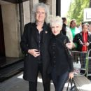 Brian May and Anita Dobson attend the Ivor Novello Awards at Grosvenor House on May 21, 2015 in London, England.