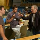 Producers Kevin Misher and Tim Bevan with director Sydney Pollack on the floor of the U.N. General Assembly filming Universal Pictures' thriller The Interpreter