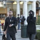 Kylie Jenner Covers her face after picking out jewelry with the Boy Toy Tyga in Calabasas, CA December 8, 2016
