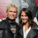 """Billy Idol, left, and Lindsey Morris attend the celebration of """"Commando: The Autobiography of Johnny Ramone,"""" Friday, April 27, 2012, in Los Angeles. The book was released in stores and online nationwide on April 2nd."""