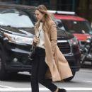 Elizabeth Olsen in a beige coat out in New York City October 16, 2017