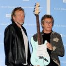 Robert Plant and Roger Daltrey pose at a press conference to announce the Daltrey/Townsend Teen & Young Adult Cancer Program at UCLA on November 4, 2011 in Los Angeles, California - 454 x 485