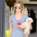 Ashley Tisdale takes her dog on a shopping trip to Planet Blue in Beverly Hills