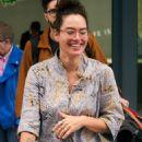 Lena Headey – Arrives back in the UK after attending the Emmy awards in LS