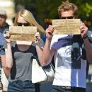 Emma Stone and Andrew Garfield holding up signs in New York City (September 15)