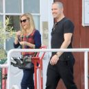 Reese Witherspoon at the Brentwood Country Market with her hubby and their son Tennessee in Brent wood, California on December 10, 2016 - 440 x 600