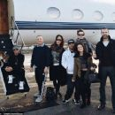 It appears the group - including Hamilton's dog Roscoe (left) - travelled to the slopes on a private plane