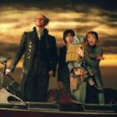 Count Olaf (Jim Carrey), Violet (Emily Browning), and Klaus (Liam Aiken) in a scene from the film.