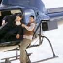 The Monk (Chow Yun Fat) fights for his life while climbing around on a helicopter