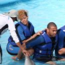 Rihanna and Matt Kemp swim with the dolphins on their Mexican getaway